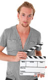 Man holding a film slate Royalty Free Stock Photo