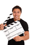 Man holding a film slate Stock Photography
