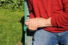 Man holding fingers and hand. Painful arthritis. Royalty Free Stock Images