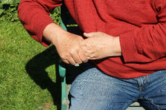 Man holding fingers and hand. Painful arthritis. Royalty Free Stock Photography