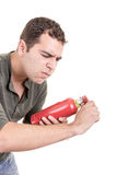 Man holding a fire extinguisher, isolated on white Royalty Free Stock Photography