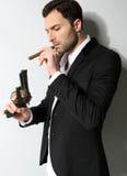 Man Holding a fire gun and smoking Stock Photos