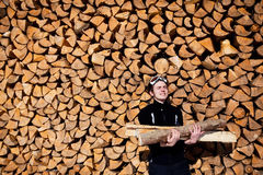 Man holding firewood. Smiling man hand holding firewood Stock Images