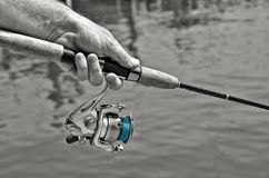 Man holding a fishing pole Royalty Free Stock Images