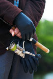 Man holding a fishing rod Royalty Free Stock Photography