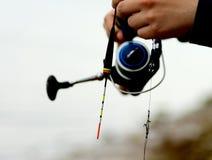 Man Holding Fishing Rod Stock Images