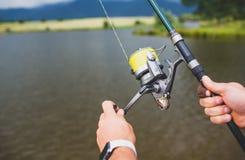 Man holding a fishing-rod. Royalty Free Stock Image