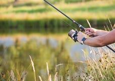 Man holding a fishing-rod. Royalty Free Stock Photos