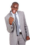 Man holding fists. Cheerful african business man holding fists on white background stock images