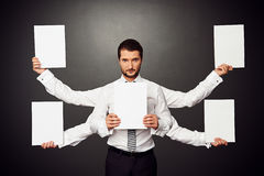 Man holding five white empty placards Stock Photos