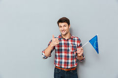 Man holding flag of Europe Union and showing thumbs up Stock Photos