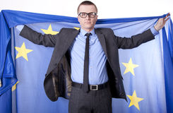 Man holding flag of European Union. With both hands Stock Photo