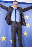 Man holding flag of European Union. With both hands Royalty Free Stock Images