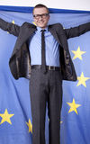 Man holding flag of European Union. And smiling Royalty Free Stock Image