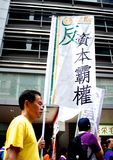 Man holding Flag in a Hong Kong Protest Stock Photos