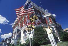 Man holding  flag of Maryland Stock Photos