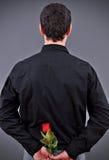 Man holding a flower Stock Photos