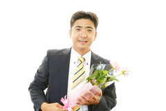 Man holding flower bouquet Royalty Free Stock Photography