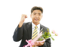 Man holding flower bouquet Stock Photo