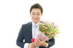 Man holding flower bouquet Stock Image