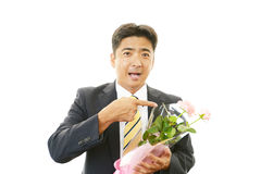 Man holding flower bouquet Stock Images