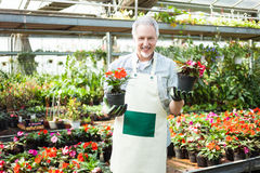 Man holding flower pots Royalty Free Stock Photo