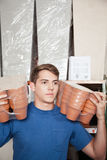 Man holding flower pots Royalty Free Stock Photography