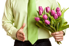 Man holding flowers Stock Images