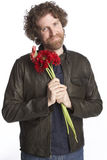 Man holding flowers Royalty Free Stock Images