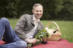 Man holding flowers and laughs Stock Image