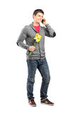 Man holding flowers and talking on the phone Royalty Free Stock Photo