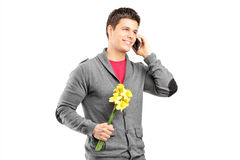 Man holding flowers and talking on the phone Stock Photo