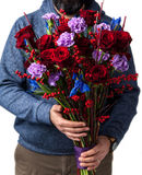 The man holding flowers in their hands Royalty Free Stock Photo