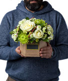 The man holding flowers in their hands Stock Photography