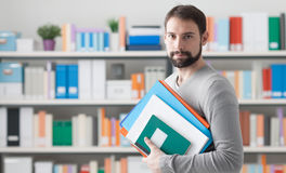Man holding folders in the office Stock Images
