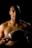 Man holding football Royalty Free Stock Images