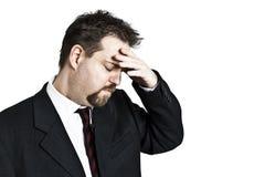 Man holding forehead Stock Photos