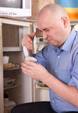Man  holding foul food Royalty Free Stock Photography