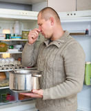 Man holding foul food Royalty Free Stock Photos