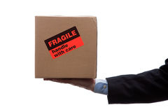 Man holding fragile moving box royalty free stock photos