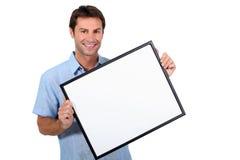 Man holding frame Stock Photography