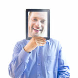 Man holding frame to face. Portrait of a man holding a transparent magnifying frame to his face.  White background Stock Photography