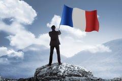Man holding france flag Stock Photos