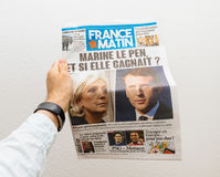 Man holding France Matin newspaper with Emmanuel Macron on first Royalty Free Stock Photos