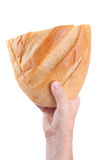 Man holding fresh bread in the hands, isolated on white background Royalty Free Stock Images