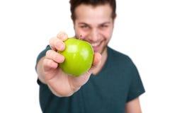 Man holding fresh green apple Stock Photos