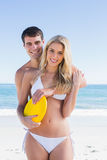 Man holding frisbee and embracing his girlfriend Stock Images