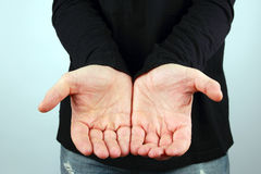 Man is holding in front of him open palm