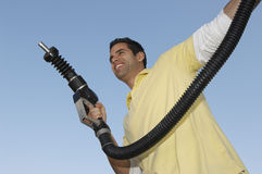 Man Holding Fuel Pump Royalty Free Stock Images