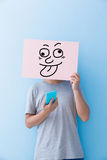 Man holding funny expression billboard royalty free stock photo